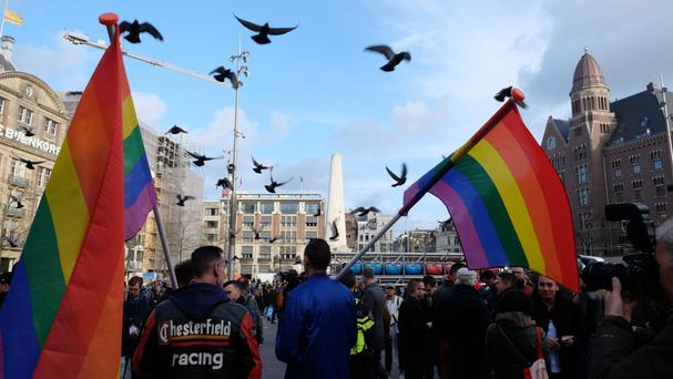 Hundreds march hand-in-hand in Amsterdam to support beaten gay couple