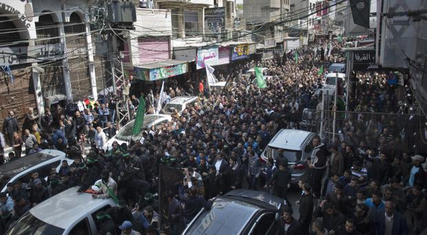 Mourners attend the funeral of Mazen Faqha in Gaza City (AP/ Khalil Hamra)