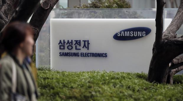 The son of the head of Samsung Electronics has appeared in court in South Korea on bribery charges (AP Photo/Lee Jin-man)