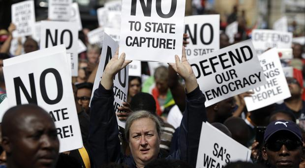 Demonstrators protest against South African President Jacob Zuma in Pretoria (AP/Themba Hadebe)