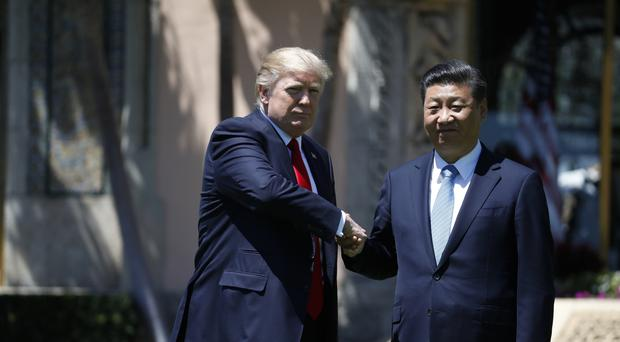 US president Donald Trump and Chinese president Xi Jinping shake hands at Mar-a-Lago in Palm Beach, Florida (AP/AlexBrandon)