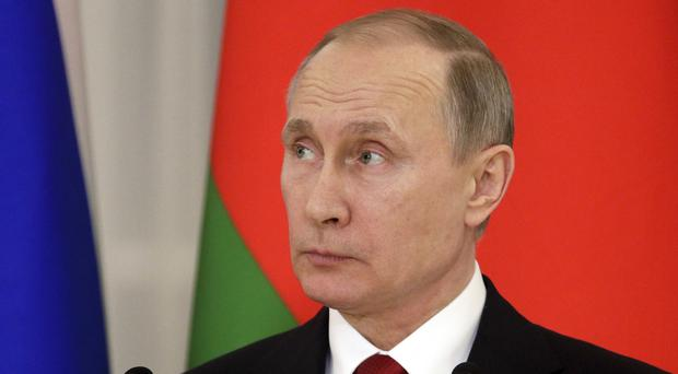 The Kremlin said in a statement that Hassan Rouhani spoke with Russian president Vladimir Putin by phone (AP)