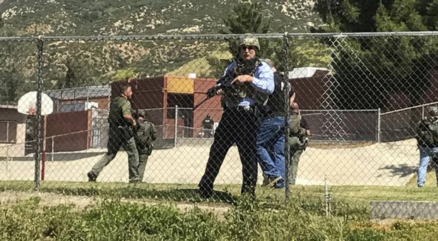 Emergency personnel respond to a shooting at North Park School in San Bernardino (Los Angeles Daily News/AP)