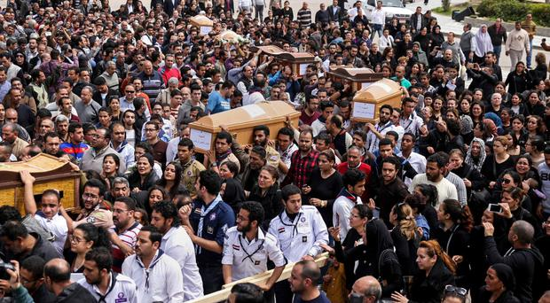 Coffins arrive for the funeral of those killed in a Palm Sunday church attack in Alexandria, Egypt