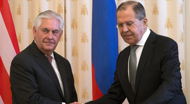 US Secretary of State Rex Tillerson and Russian Foreign Minister Sergey Lavrov shake hands. (AP/Alexander Zemlianichenko)