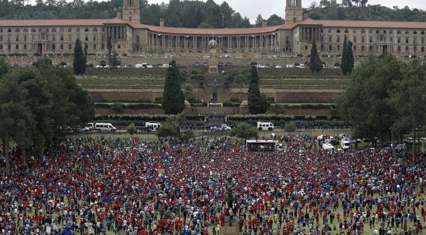 Members of the opposition parties protest outside the Union Buildings in Pretoria, South Africa. (AP/Themba Hadebe)