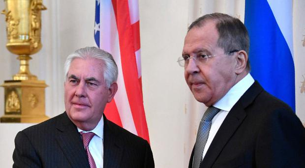 Russian Foreign Minister Sergei Lavrov (right) welcomes US Secretary of State Rex Tillerson before a meeting in Moscow yesterday