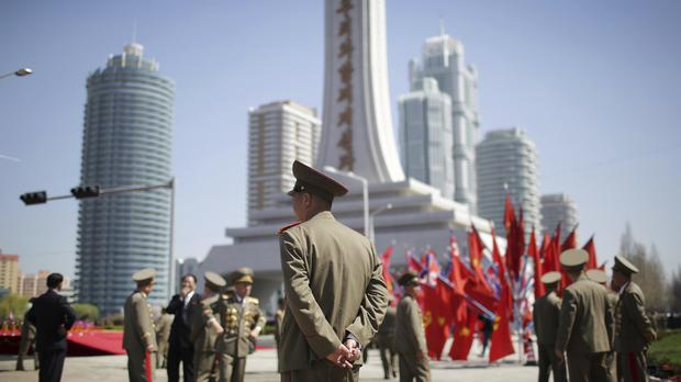 North Korean military soldiers walk along the Ryomyong residential area. (AP/Wong Maye-E)