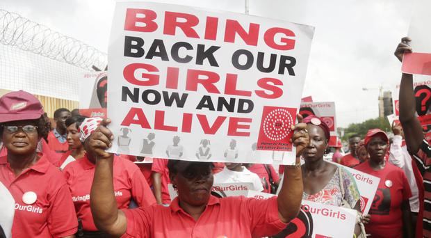 Bring back our girls campaigners during a protest in Lagos, Nigeria. (AP/ Sunday Alamba)