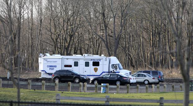Emergency vehicles are parked near the site where four bodies were discovered in Central Islip. (AP/Seth Wenig)