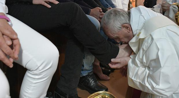 Pope Francis washes the feet of inmates at the Paliano detention centre south of Rome (L'Osservatore Romano/Pool Photo via AP)