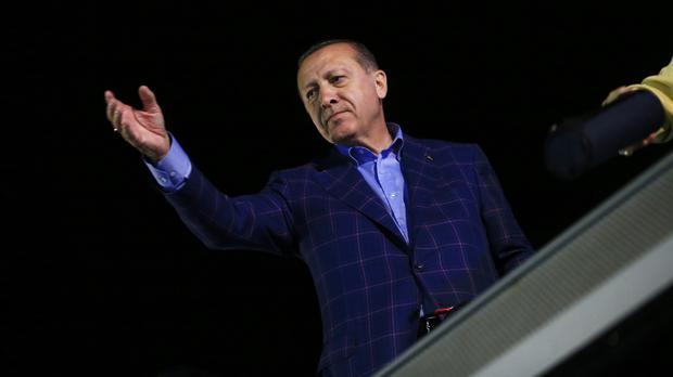 Recep Tayyip Erdogan, waves to supporters in Istanbul after declaring victory in a historic referendum that will grant sweeping powers to the presidency (AP Photo/Lefteris Pitarakis)