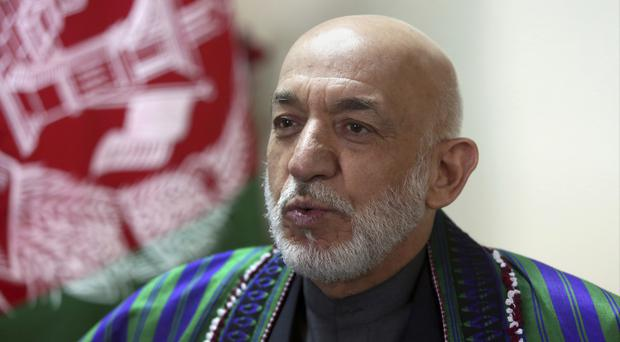 Hamid Karzai harshly criticised the Afghan government for allowing the use of the bomb (AP/Rahmat Gul)