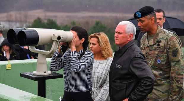 US Vice President Mike Pence visits an observation post with his daughters on the border between North and South Korea yesterday