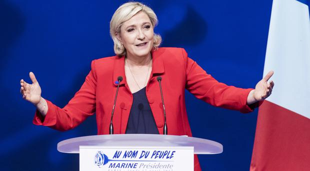 Far-right candidate Marine Le Pen in full flow at the rally in Paris (AP)