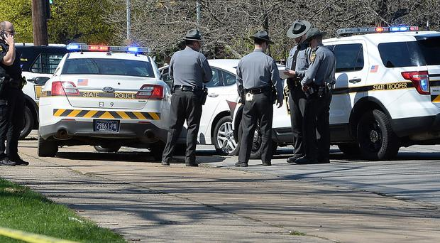Police at the scene where Steve Stephens shot himself after a car chase (Erie Times-News/AP)