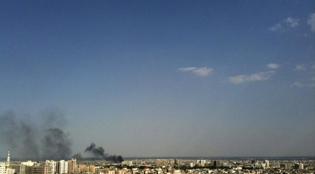 Smoke rises over the skyline in the Qaboun neighbourhood of Damascus, Syria, during shelling by Syrian government forces (AP Photo, File)