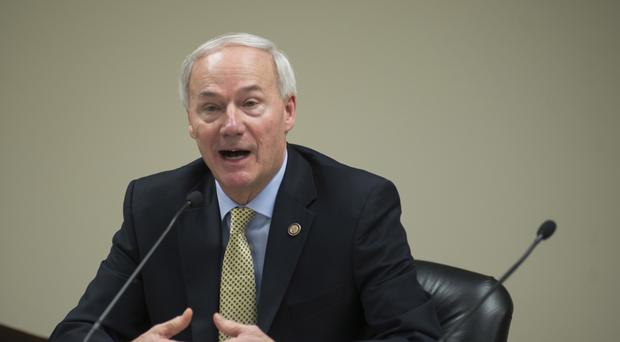 Arkansas Gov Asa Hutchinson speaks to members of the press