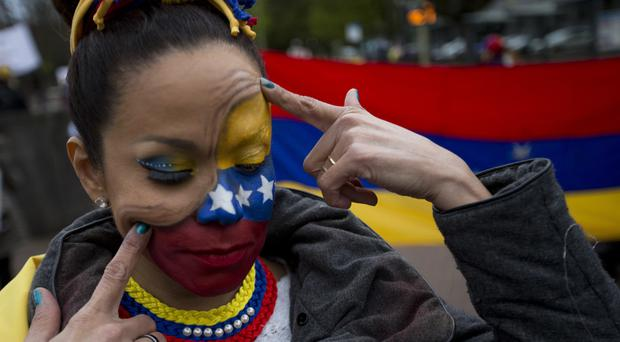 Human rights activists protest against the current situation in Venezuela. (AP/Peter Dejong)