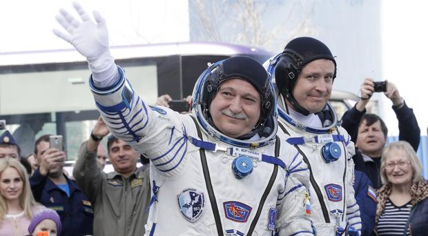 Astronaut Jack Fischer, right, and Russian cosmonaut Fyodor Yurchikhin, preparing for their space flight