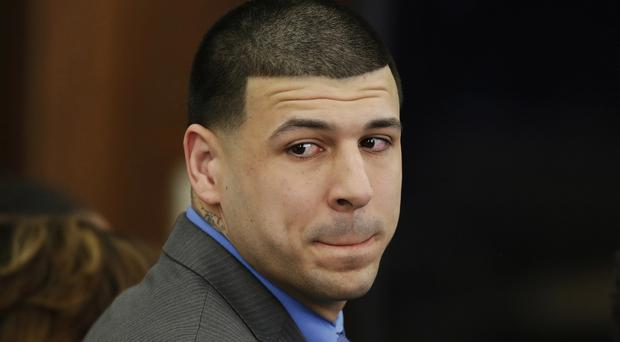 Aaron Hernandez pictured as he was cleared of a double murder earlier this month (Stephan Savoia/AP)