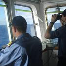 The crew of survey ship HMS Echo helps in the underwater search for the flight recorder from missing Malaysia Airlines flight MH370 in the southern Indian Ocean