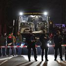 Police officers stand in front of Dortmund's damaged team bus (AP/Martin Meissner)