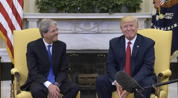 President Donald Trump meets Italian Prime Minister Paolo Gentiloni in the White House (AP Photo/Susan Walsh)