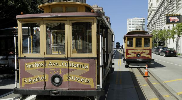 Cable cars sit idle in California Street during the power cut (AP)
