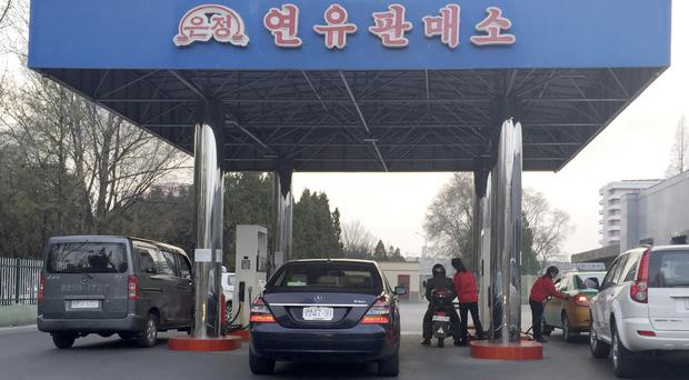 Cars line up at at a petrol station in Pyongyang (AP)