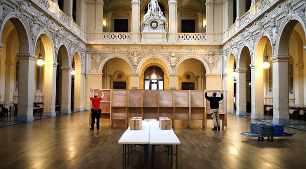 Workers prepare voting booths at a polling station in Lyon, France. The two-round presidential election will take place on April 23 and May 7. (AP Photo/Laurent Cipriani)