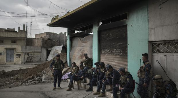 Federal police gather before moving to the frontline near the old city during fighting against IS militants on the western side of Mosul (Felipe Dana/AP)