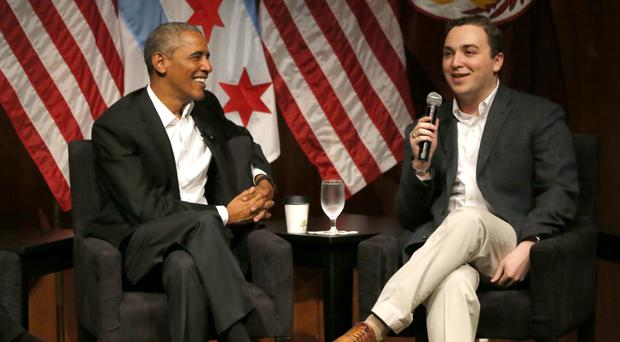 Former president Barack Obama listens to Max Freedman during a conversation on civic engagement and community organising at the University of Chicago (AP)