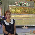 Chiranut Trairat sits in front of her daughter's coffin (AP)