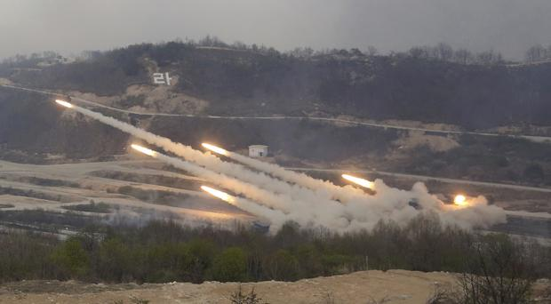 South Korean army's multiple launch systems fire rockets during live drills. (AP/Ahn Young-joon)