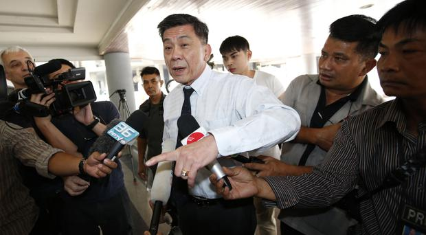 Director-general of South Bangkok Prosecutor's Office Suthi Kittisupaporn talks to reporters (AP Photo/Sakchai Lalit)