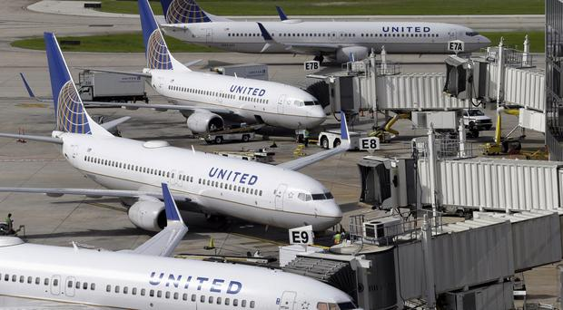 United has settled the case with passenger David Dao, who was removed from a flight earlier this month (David J Phillip/AP)