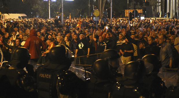 Police block protesters entering into the parliament building in Skopje, Macedonia (AP)
