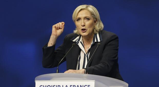 Marine Le Pen addresses supporters during an election campaign rally in Nice (AP)