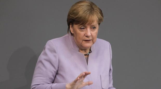 The bill was proposed by security officials from German Chancellor Angela Merkel's conservative bloc (AP)