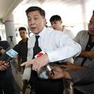 Chief prosecutor Suthi Kittisupaporn talks to reporters after Vorayuth Yoovidhya missed deadline to answer a summons