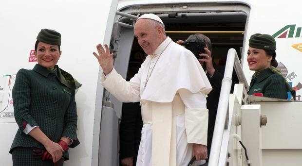 Pope Francis boards a plane on his way to Cairo (L'Osservatore Romano/AP)