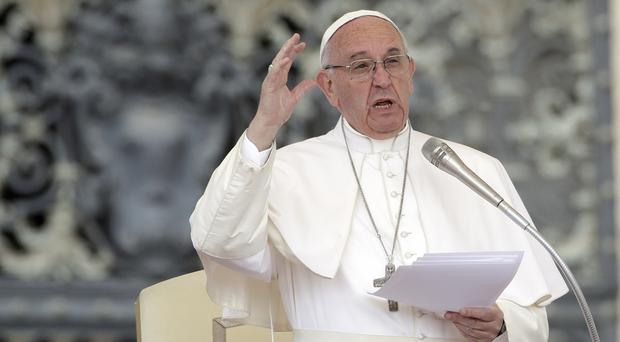 Pope Francis speaks in St Peter's Square at the Vatican (AP)
