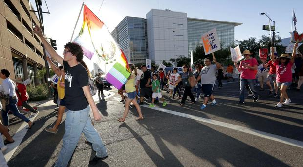 Protesters march through Phoenix, Arizona (AP)