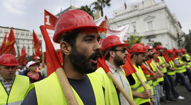 Protesters rally outside the Greek parliament in Athens as unions braced for more austerity measures imposed by bailout lenders (AP/Thanassis Stavrakis)