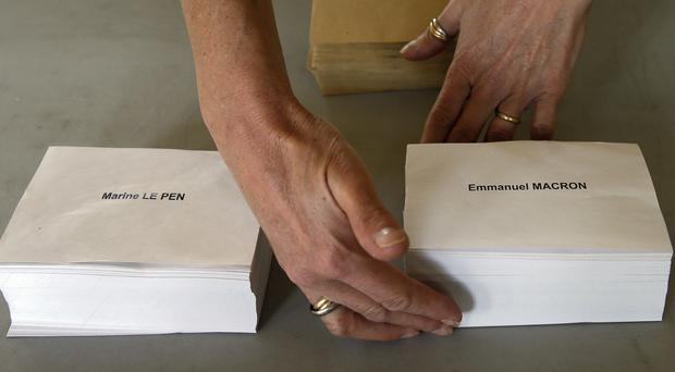 Ballot papers are readied at a polling station in Bayonne, south-western France (AP)