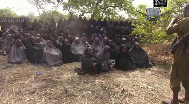 Some of the abducted Chibok girls pictured by Boko Haram in 2014 (AP)