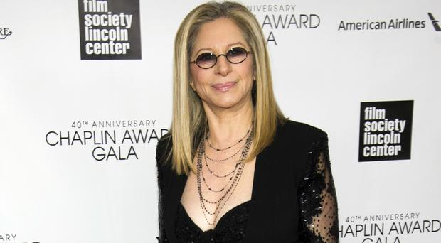 Barbra Streisand hailed Bill and Hillary Clinton and ridiculed Donald Trump at her New York concert