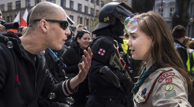Lucie Myslikova was photographed talking to a protester at a right-wing demonstration in Brno (Vladimir Cicmanec/AP)