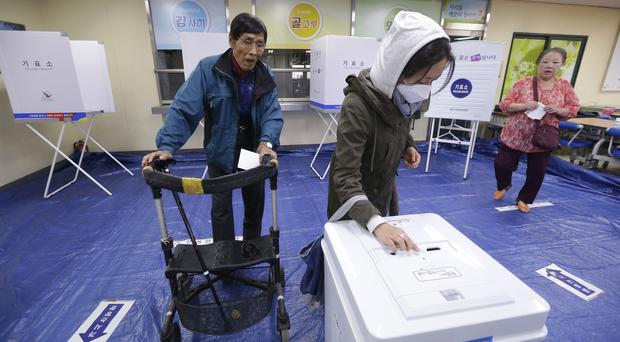 Voters at a polling station in Seoul, as South Koreans are voting for a new president (AP Photo/Ahn Young-joon)